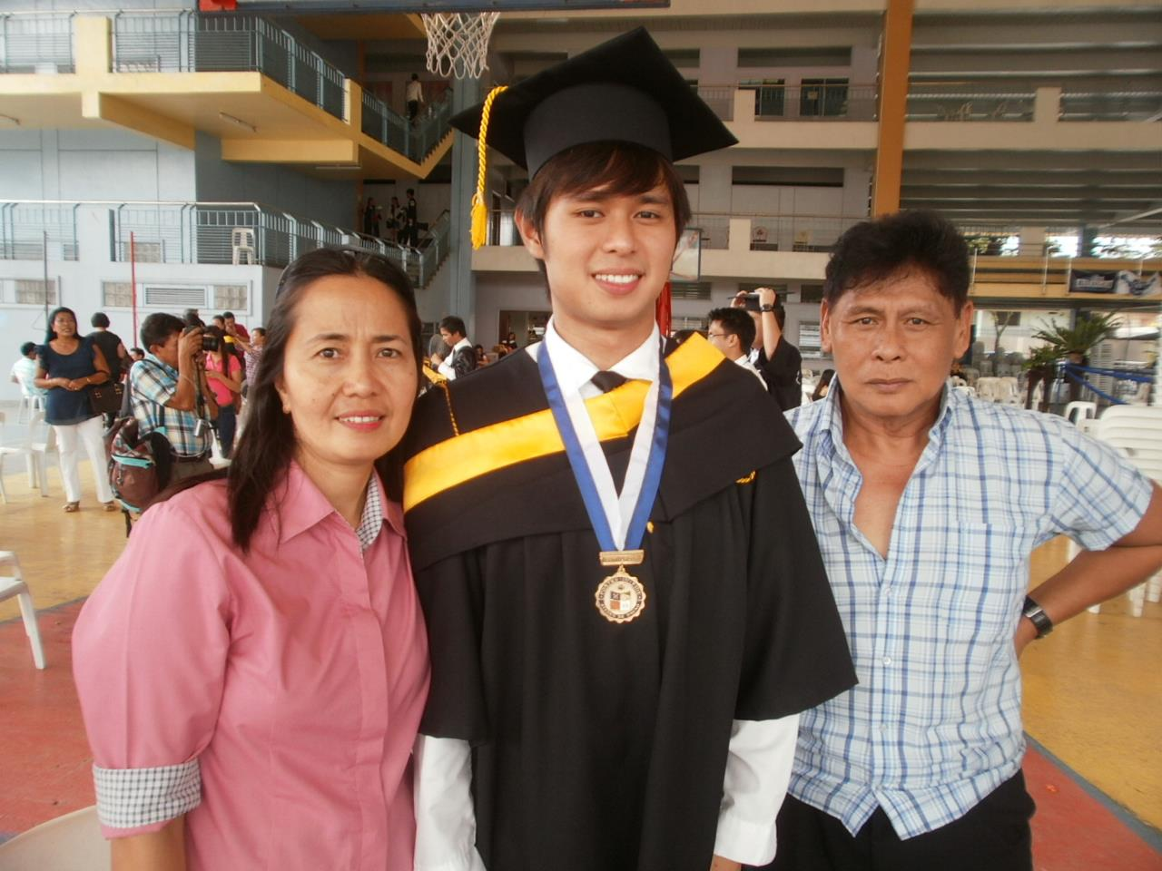 During the March 2012 Commencement Exercises, Richard's second graduation ceremony, at Martinez Sports Complex, AdDU Matina Campus with his Parents. He also graduated year 2007 with Bachelor's Degree in Nursing